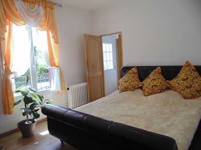 Photo for 8min walking distance to train station, Cozy King size bed ..