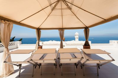 Large solarium overlooking Capri and the bay of Naples; sunbeds, shower, seaview