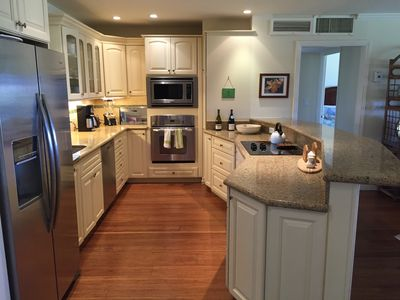 Kitchen with new appliances, pull out pantry, glass top stove,