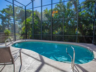 Photo for 6BR home with private heated pool close to beach