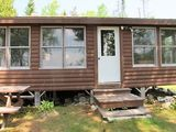 This cabin is cute as a button! You will love the sandy common beach area!