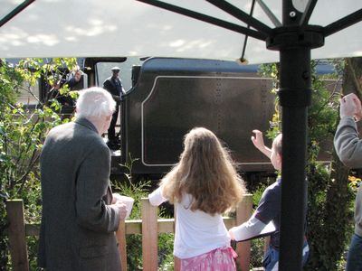 Waving at the trains from the patio at Railway Cottage