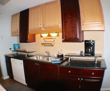 Fully stocked kitchen with granite countertops.