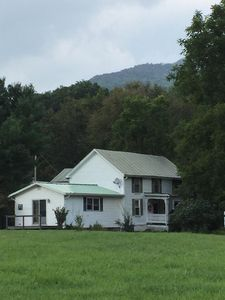 Farmhouse with Devil's Backbone - a mountain climber favorite - in background