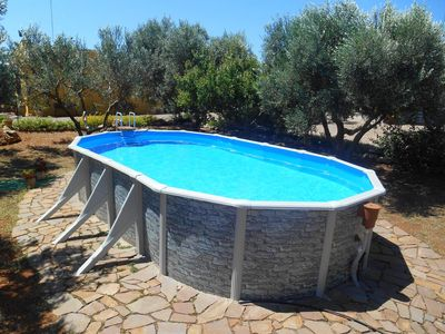 Photo for Homerez last minute deal - Nice house with pool access and Wifi