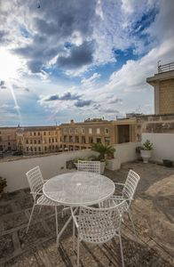 Photo for Penthouse with large terrace on Piazza Sant'Oronzo (Discounts for long periods)
