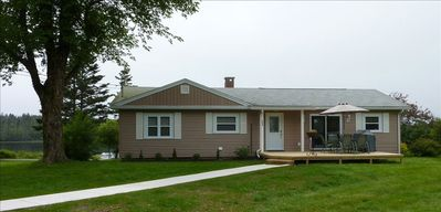 Front entrance, Patio Doors, sheltered deck, 6 person Patio set and Propane BBQ