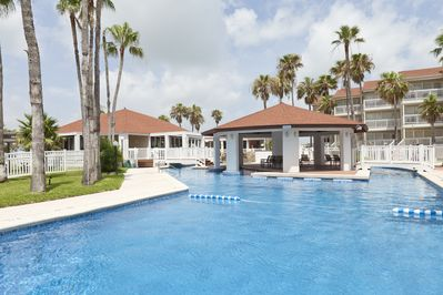 Swimming pool area with middle gazebo.