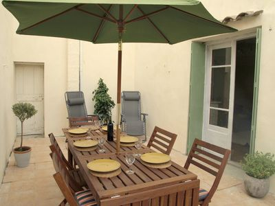 Terrace sun trap with double doors to lounge