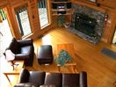 Luxurious leather sofa set to cuddle up in front of the real stone fireplace