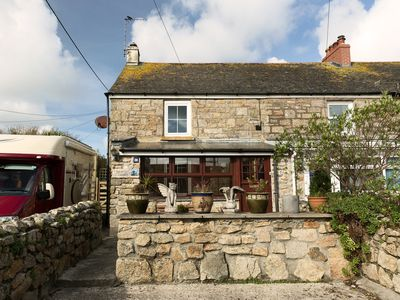Photo for Beautiful granite cottage with parking and garden. Near the coast. Dogs welcome.