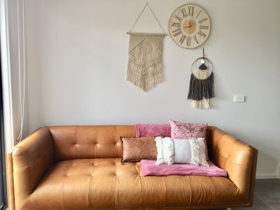 Modern leather couch and soft Wall art