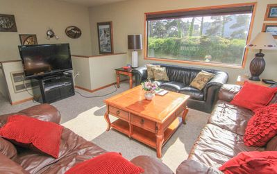 Photo for Central Location, Two Living Areas and Hot Tub Just a Block from Beach Access