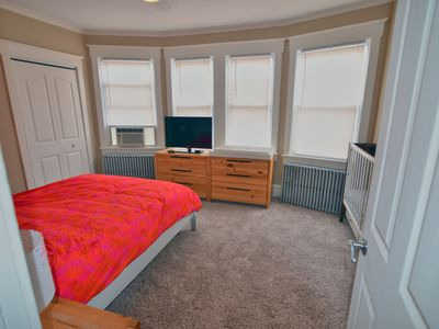 Master Bedroom complete with Queen Bed, Crib, 32' TV, Changing table