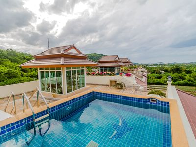 Photo for Penthouse with roof top pool sea view in