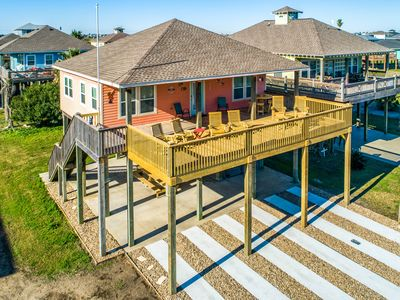 Photo for NEW LISTING! Charming beach house with extended deck-steps from the beach!