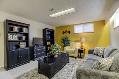 Living area with a groovy yellow polka-dot chair!