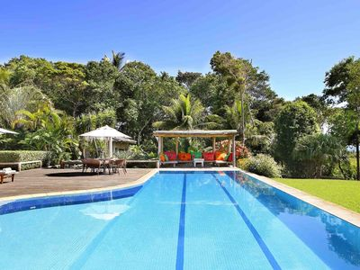 Photo for A spectacular garden with pool and sea views await you in Trancoso.