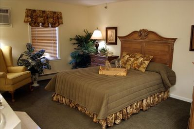 Queen bed in spacious bedroom.