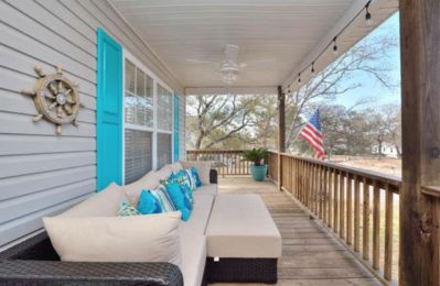 Outdoor Seating with view of Intracoastal Waterway on Front Covered Porch