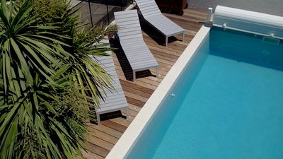 Photo for Large holiday home with pool just steps from the beach