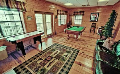 Game room with pool table, air hockey and a multi cade.