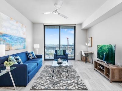 Photo for Sunny Balcony! Modern Worldcenter Condo with Pool