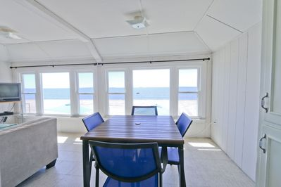 white house upstairs unit with 3 bdrs; ocean front; notice sofa has full vie