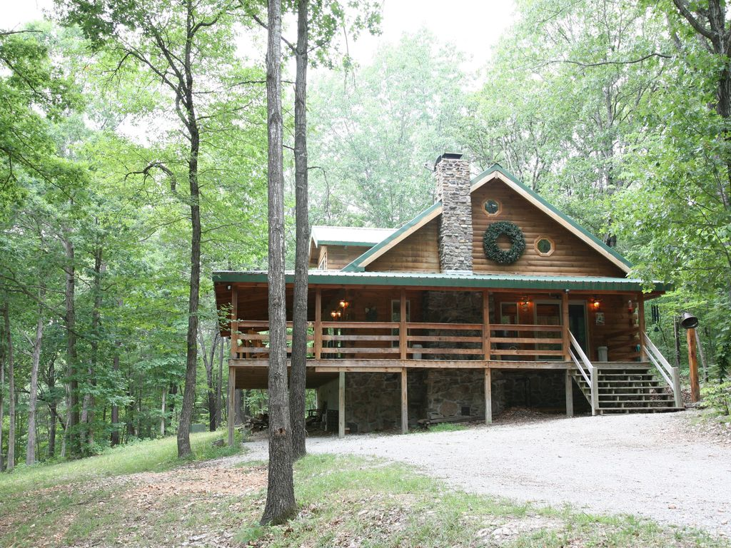 2 story log cabin on 50 acres. large fireplace, hot tub, covered