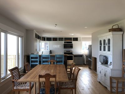 Open concept kitchen and dining with breakfast bar overlooking ocean