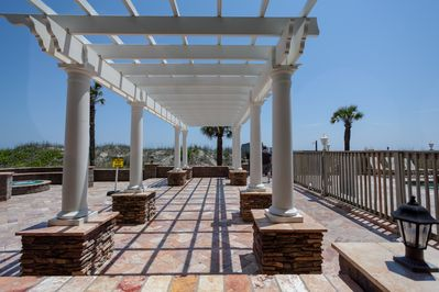 Pergola and patio area for large gatherings, sunbathing, corn hole, and more.