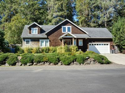 Photo for This secluded suburban home sleeps 10 and is moments away from the beach!