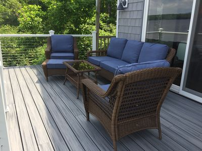 New deck furniture overlooking lake.