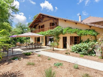 Photo for Spacious farmhouse with private heated pool in a rustic garden.