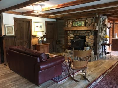 One of the cozy Living  areas, this one with a wood stove and leather sofa.