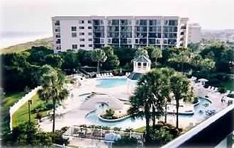 View of pool and lazy river from balcony - Litchfield by the Sea