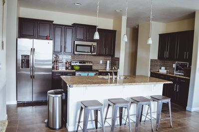 Granite counters in the kitchen with large center island, and plenty of storage