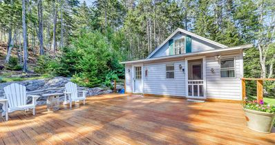 Overlook cottage with generous deck connecting to garage apartment