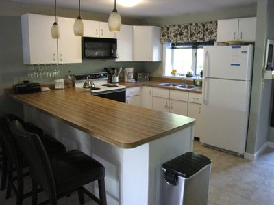 Photo for Spacious 4 level townhouse, great location, outdoor heated pool, family friendly