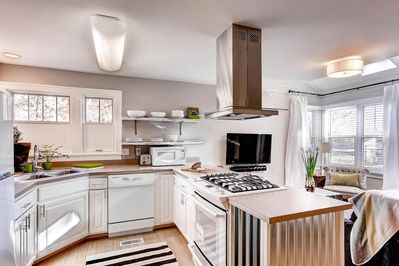 Kitchen with gas range and proper pans and knives