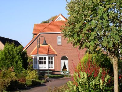 Photo for Elegant and peaceful vacation home in the North Sea spa Dornumersiel