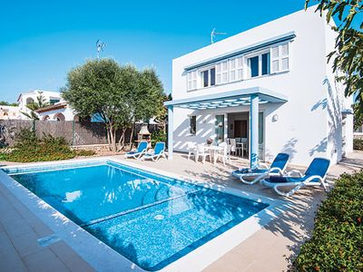 Photo for A modern villa perfect for families - walking distance to bustling marina & sandy beach
