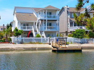 4bd Canal Front home with an Elevator, dock, fenced back yard, 2 master suites