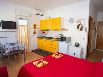 Photo for holiday apartment in Lignano Sabbiadoro a few steps from the sea