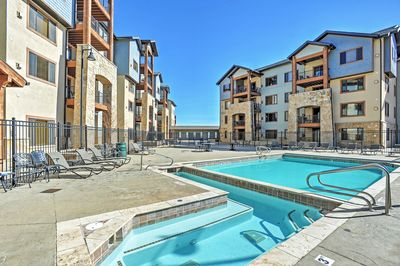 Relax in the private pool of this Park City vacation rental condo.