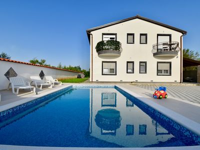 Photo for Holiday apartments with pool and spacious backyard with grill