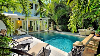 The pool area is lushly landscaped...