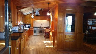 Skylit Gourmet Kitchen as seen from side entry door.