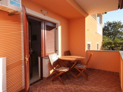 Photo for One bedroom apartment with terrace and sea view Peroj, Fažana (A-7254-b)