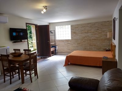 Photo for Studio apartment just steps from the wonderful Julião Beach